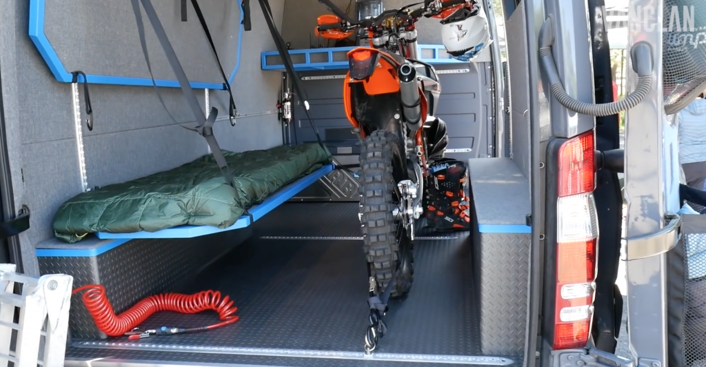 Bike secured down using the L-track storage system