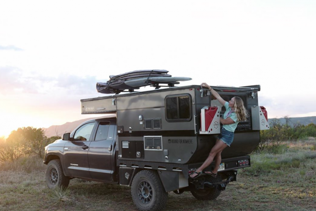 Toyota Tundra Camper with Mak climbing up onto the back. She looks as though she's at the local climbing wall!