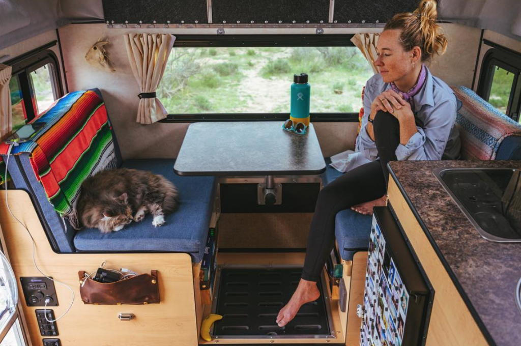 Toyota Tundra Camper office area that doubles up as a bed, shower, and cat lounge.