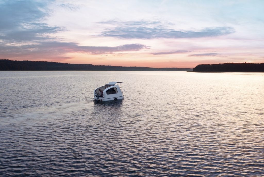 Amphibious camper - On water at sunset