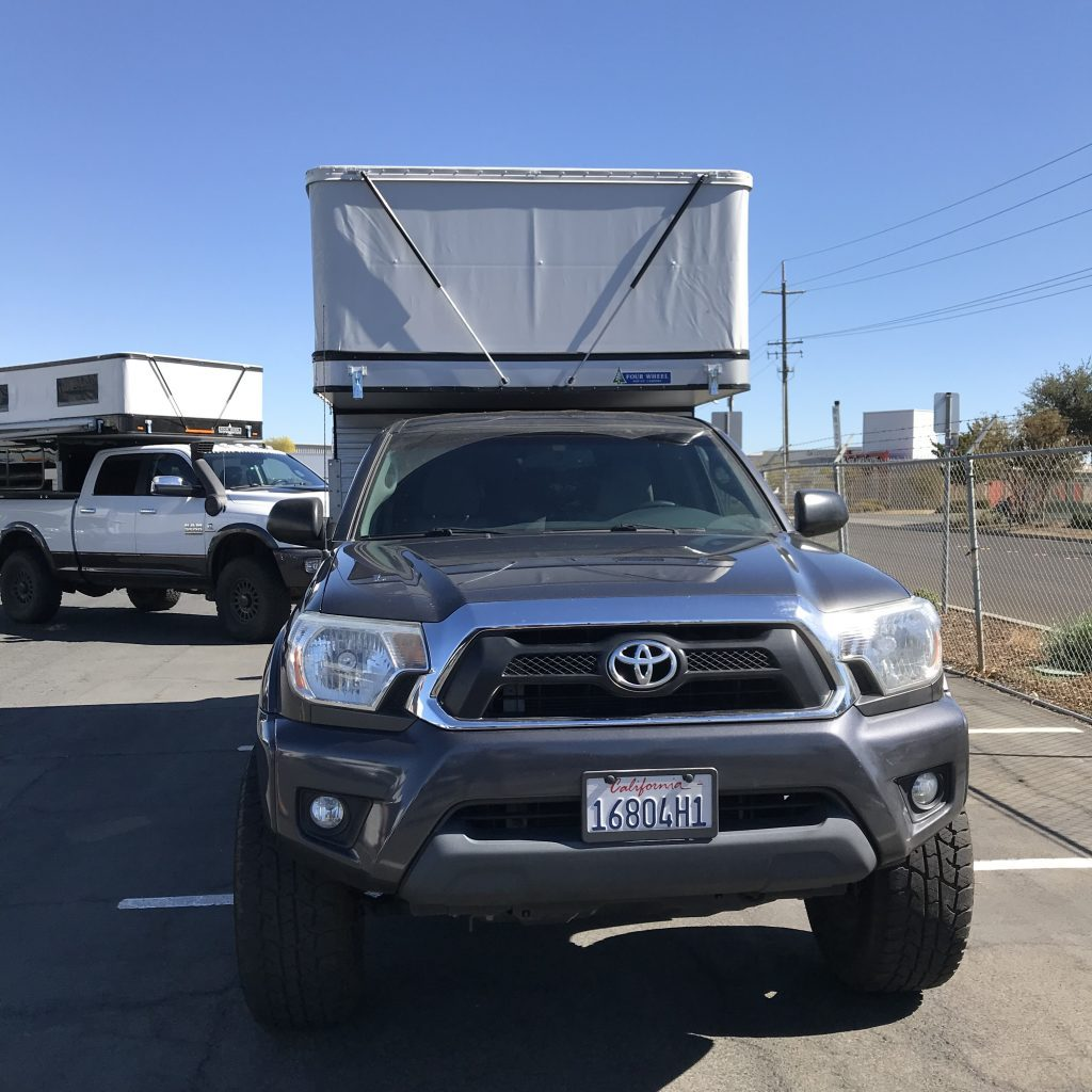 Toyota Tacoma Camper with the pop topped outside the FWC factory