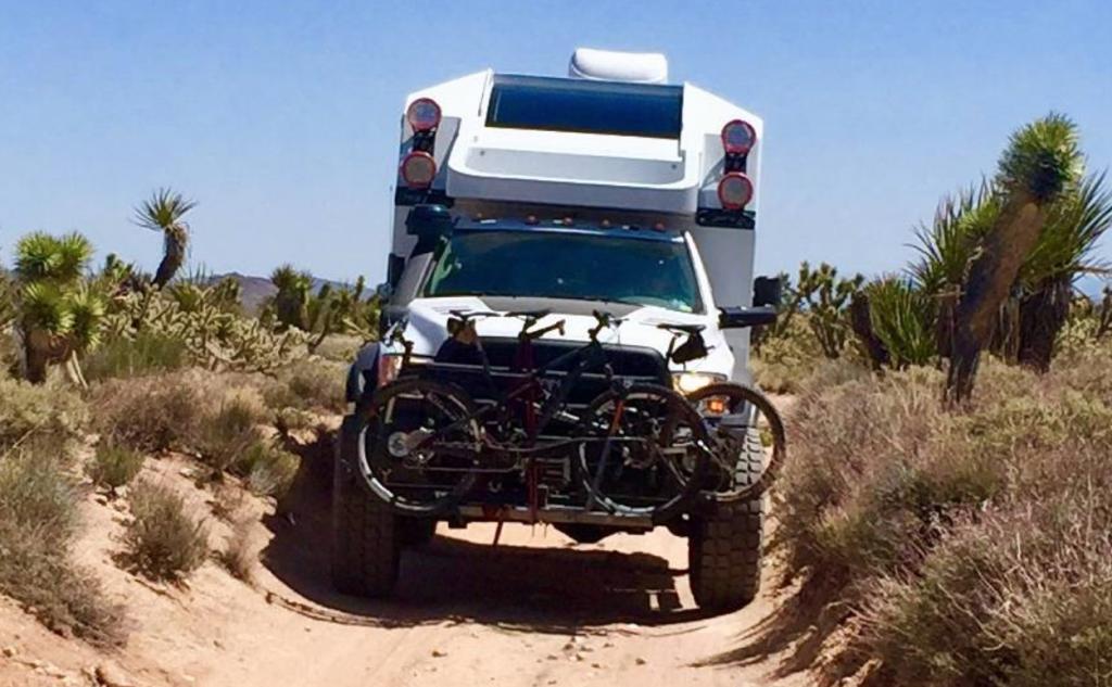 Adventure Truck cruising along a sandy track