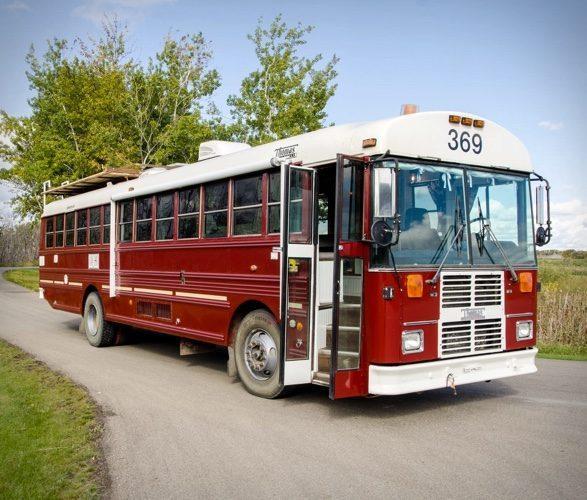 PTP School Bus Conversion - crimson paint exterior with the classic double open-out doors