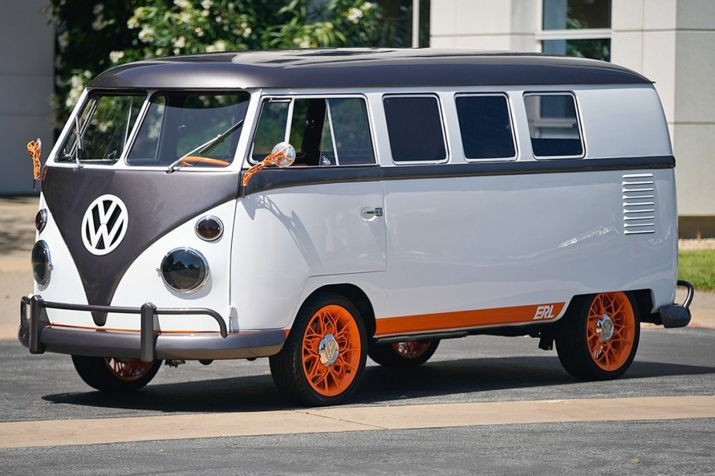 A white and black VW split screen bus; not what you might expect to see on a list of electric campervans.