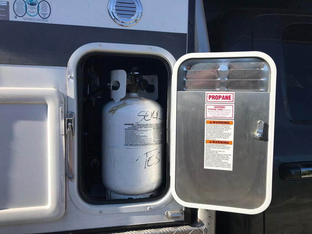 Gas canisters in these pop up truck campers