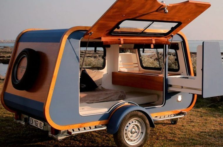The Carapate Adventure trailer - blue, with door open showing the cosy interior