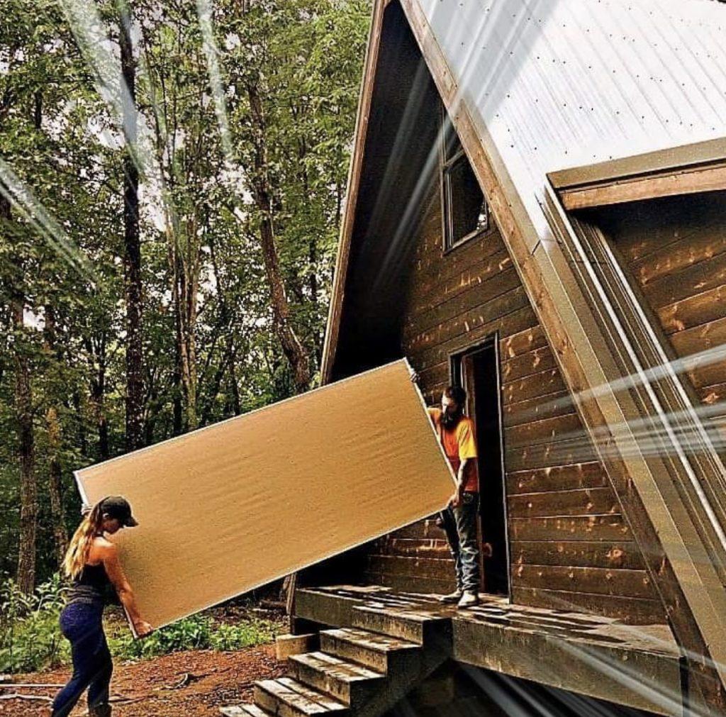 Couple building their A frame cabin.