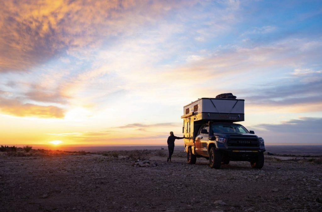 Living in a four wheel camper- camper in sunset.