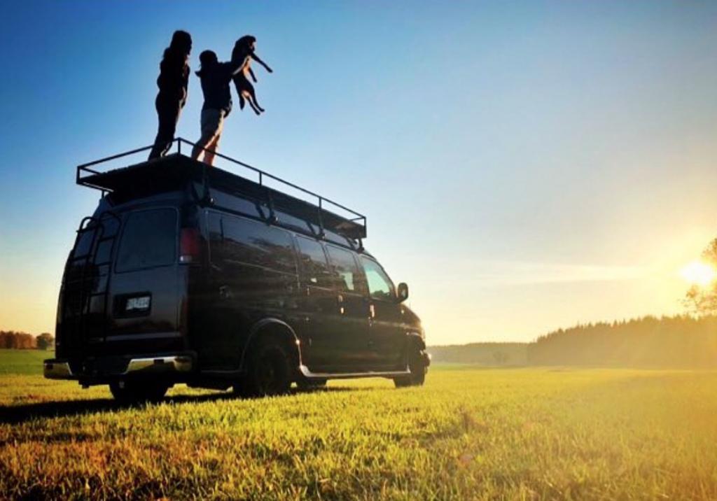 Standing on top of a van