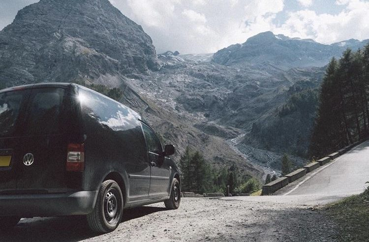 Camper on narrow mountain road.