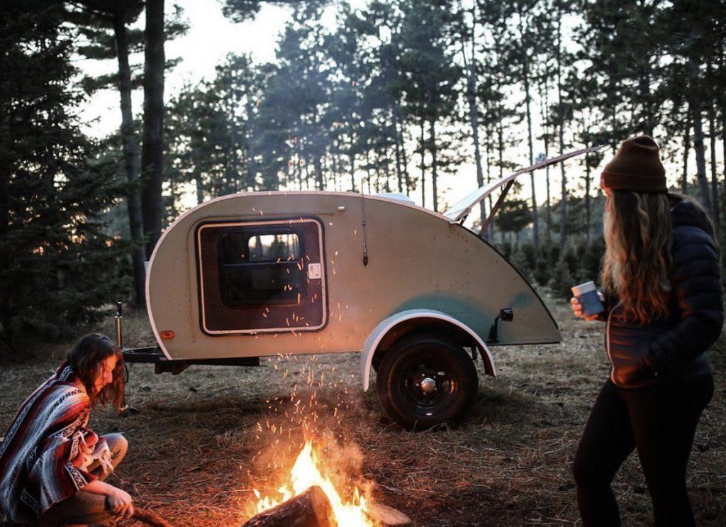 campfire infront of teardrop trailer