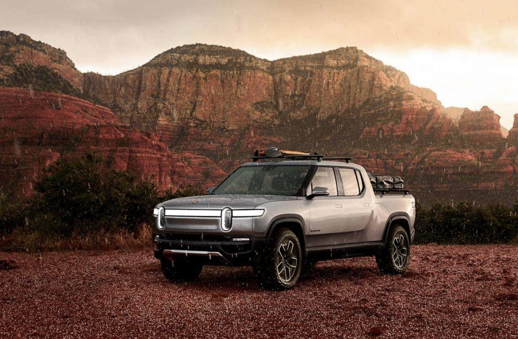 Rivian Electric Truck in front of rocky mountains