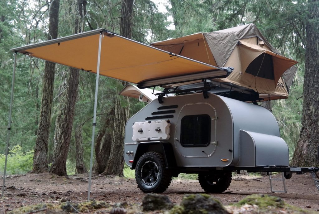 Best teardrop campers - the TerraDrop complete with roof tent and awning in a forest setting
