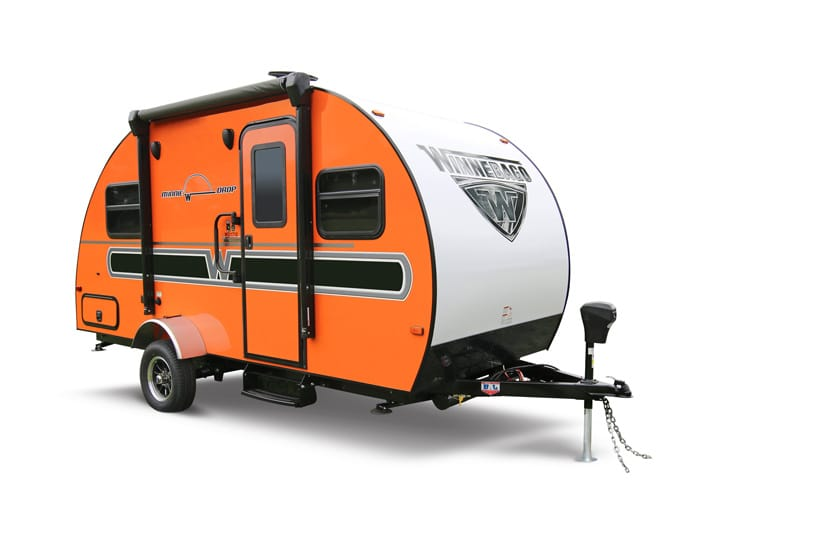 Best teardrop campers - The Minnie Drop from Winnebago with a vibrant orange side panel and company logo graphic on the curve.