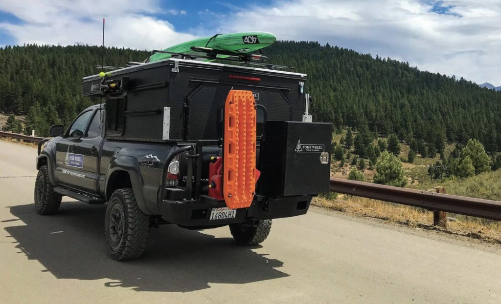 Best Adventure Vans - Project M exterior with SUP on roof and gear on back