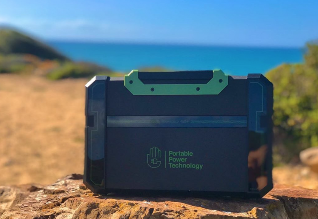 best trailer accessories - a portable power pack on the beach in Sardinia