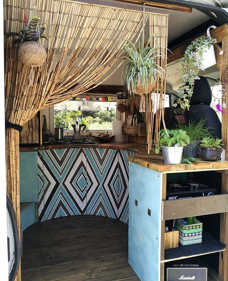 Custom van ideas- funky curved kitchen viewed through side door with blue and white diamond painted pattern on cabinetry