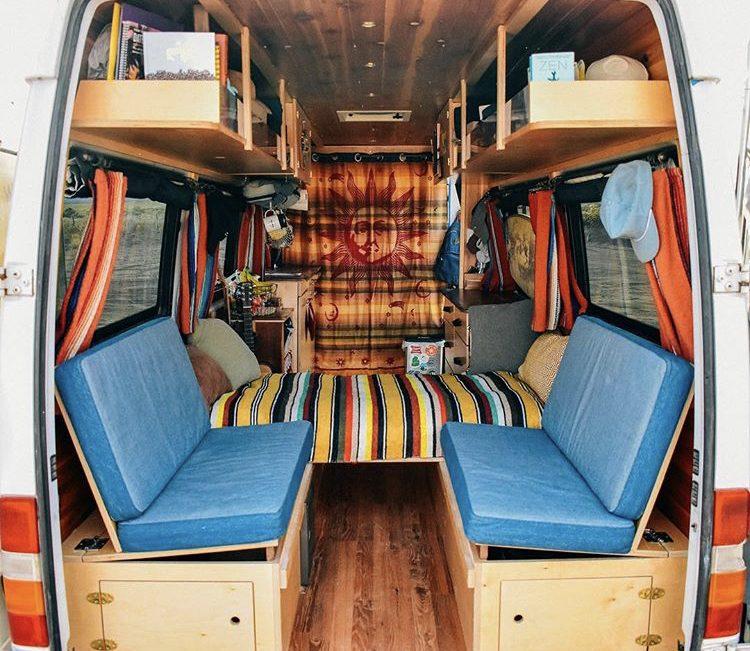 Van interior with seats half up, half down.