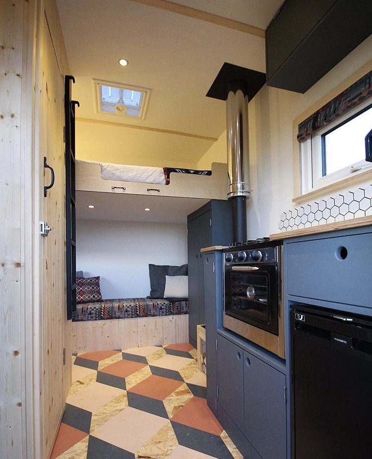 Custom van ideas - van interior with loft bed and blue kitchen.