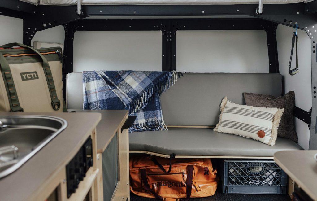 Taxa Mantis interior, grey bench seat and storage.