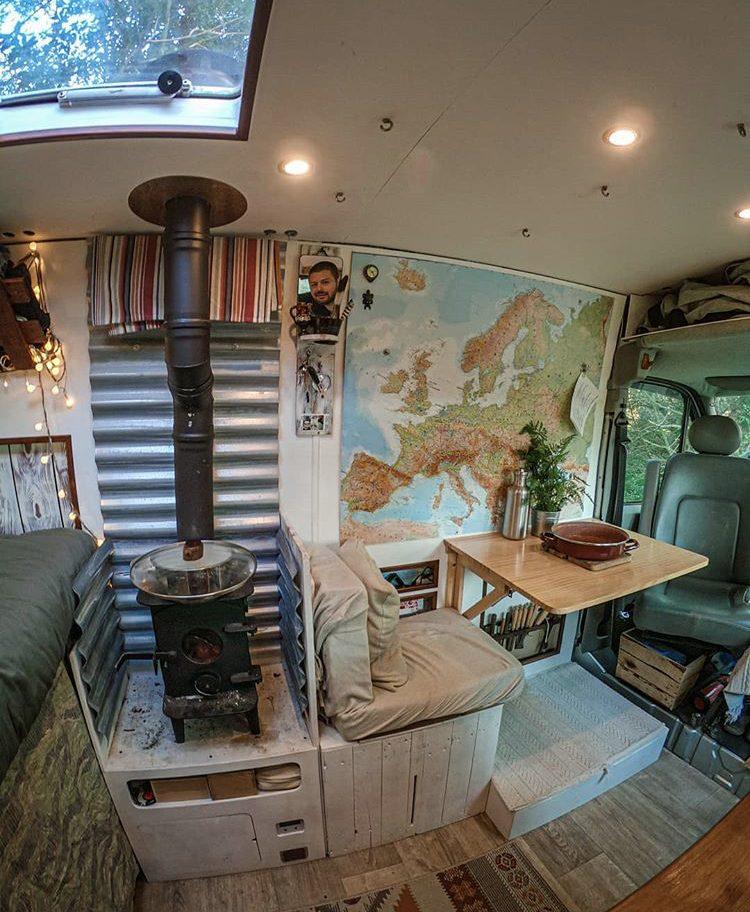 Interior of van with woode burner no table.