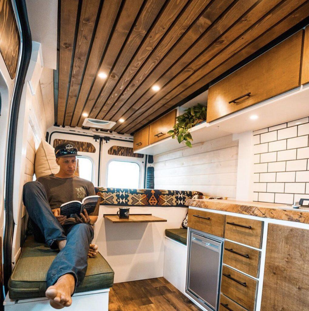 white and wooden campervan interior