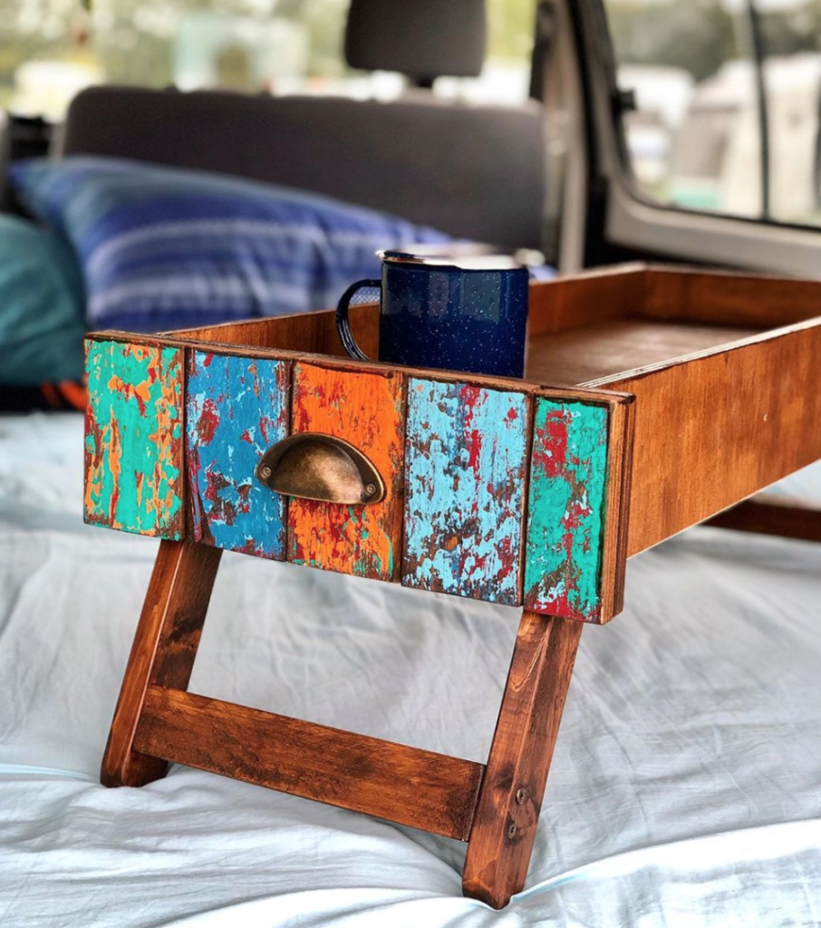 Fold out table storage in a van