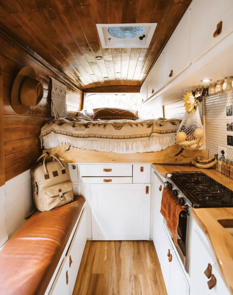 white and wooden cmapervan interior