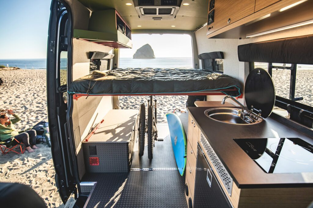 Bed in bed position in van