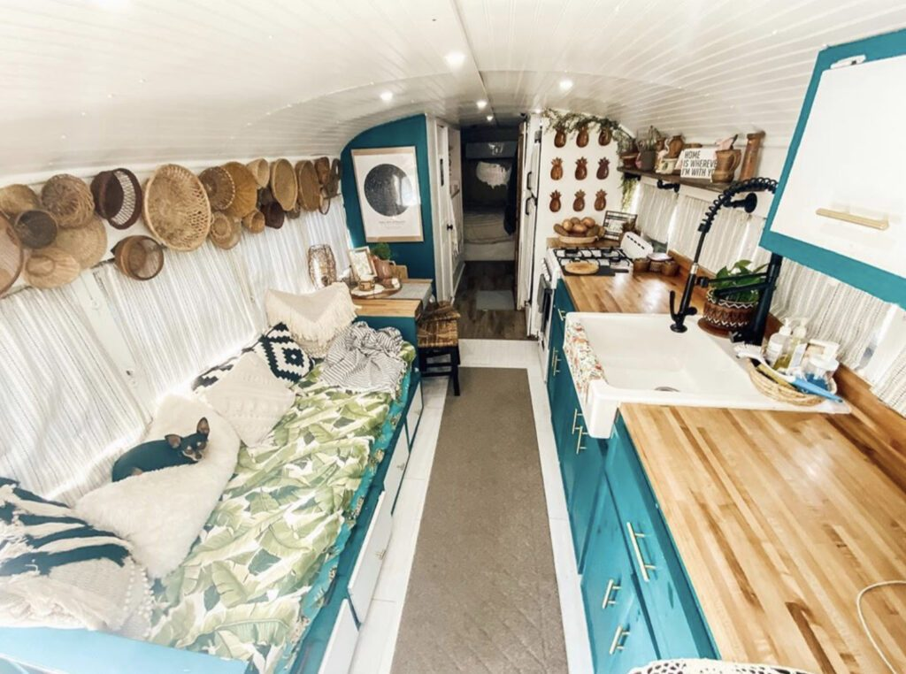 White washed wooden interior with turquoise cabinets