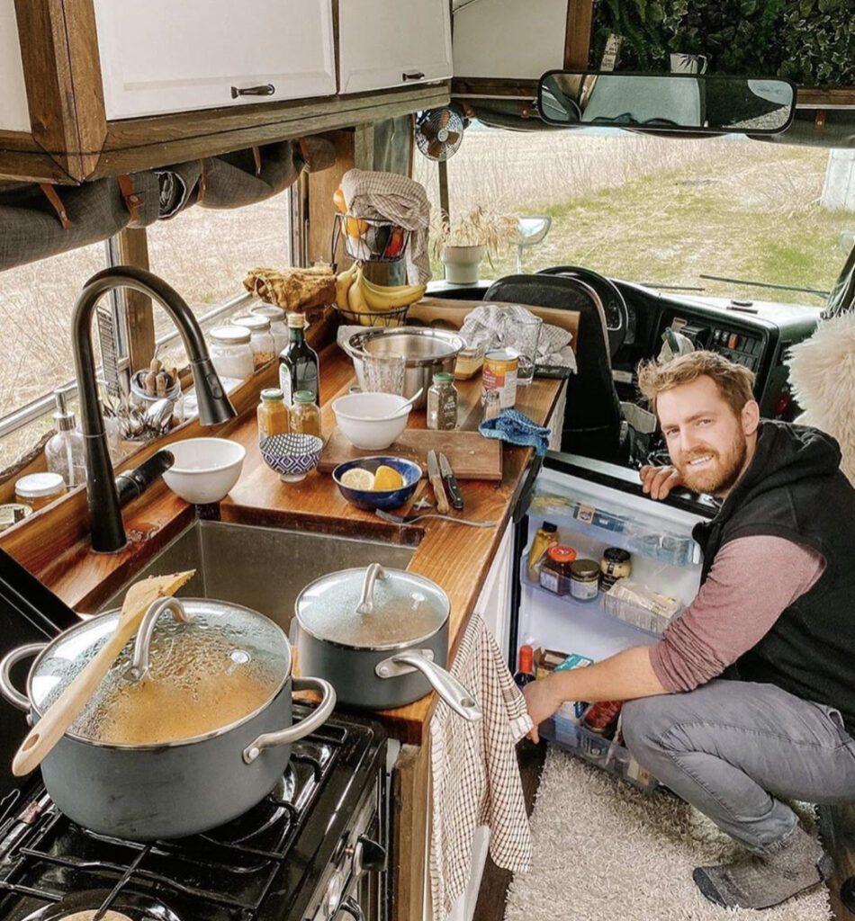 Man cooking inside camper