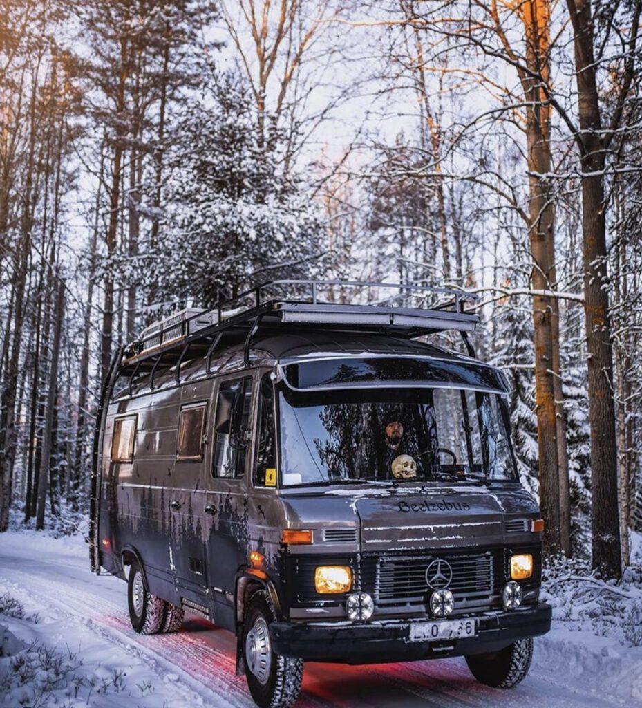 van in snowy forest