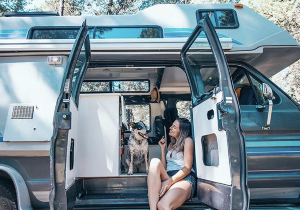 Camping with dogs - woman and her dog in camper