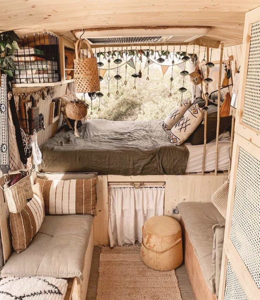 Van home: camper decorated in neutral tones and with plants and bunting