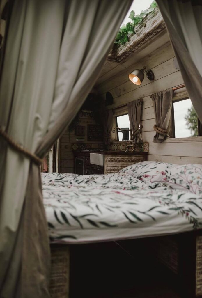 Bed converts from the sofa - Handcrafted Rustic Campervan
