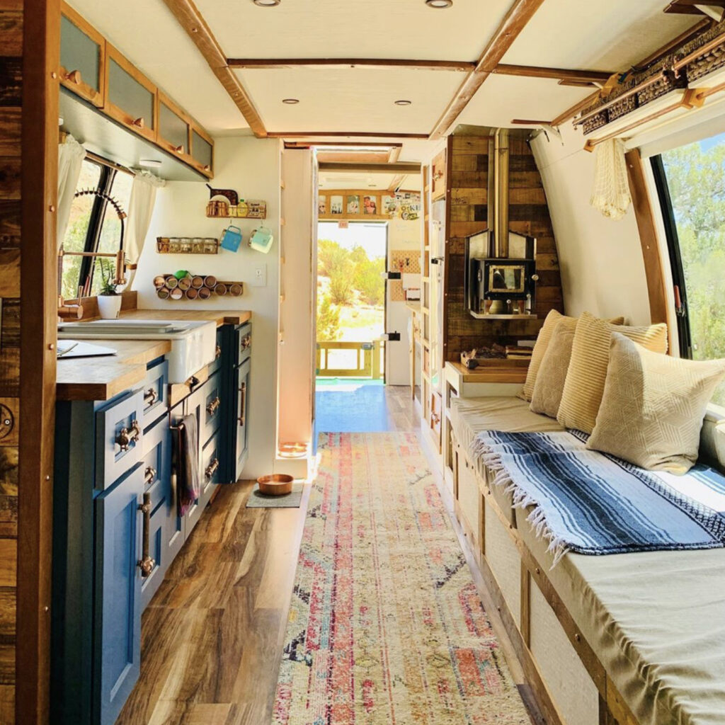 Bus conversion - blue kitchen and lots of seating space
