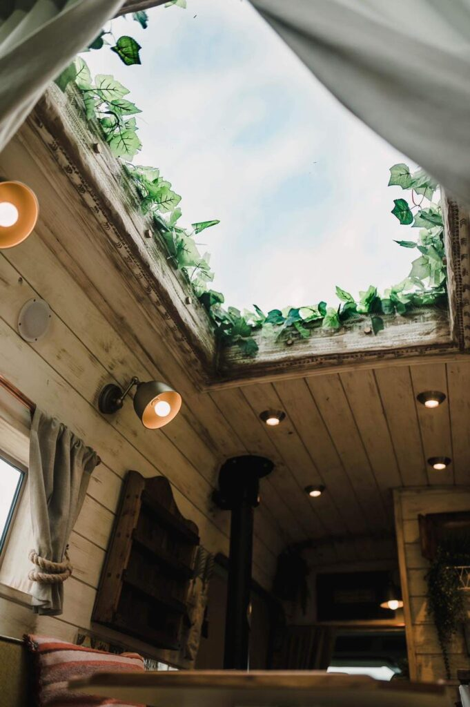Fake plants bring nature into the space - Handcrafted Rustic Campervan