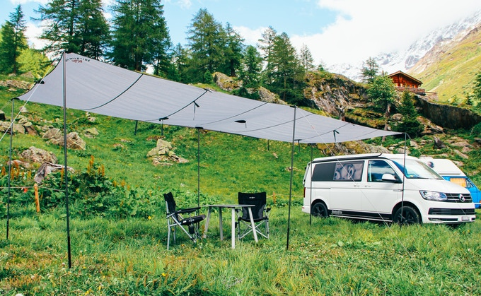 The Wildside campervan tarp is super long and provides shelter anywhere.