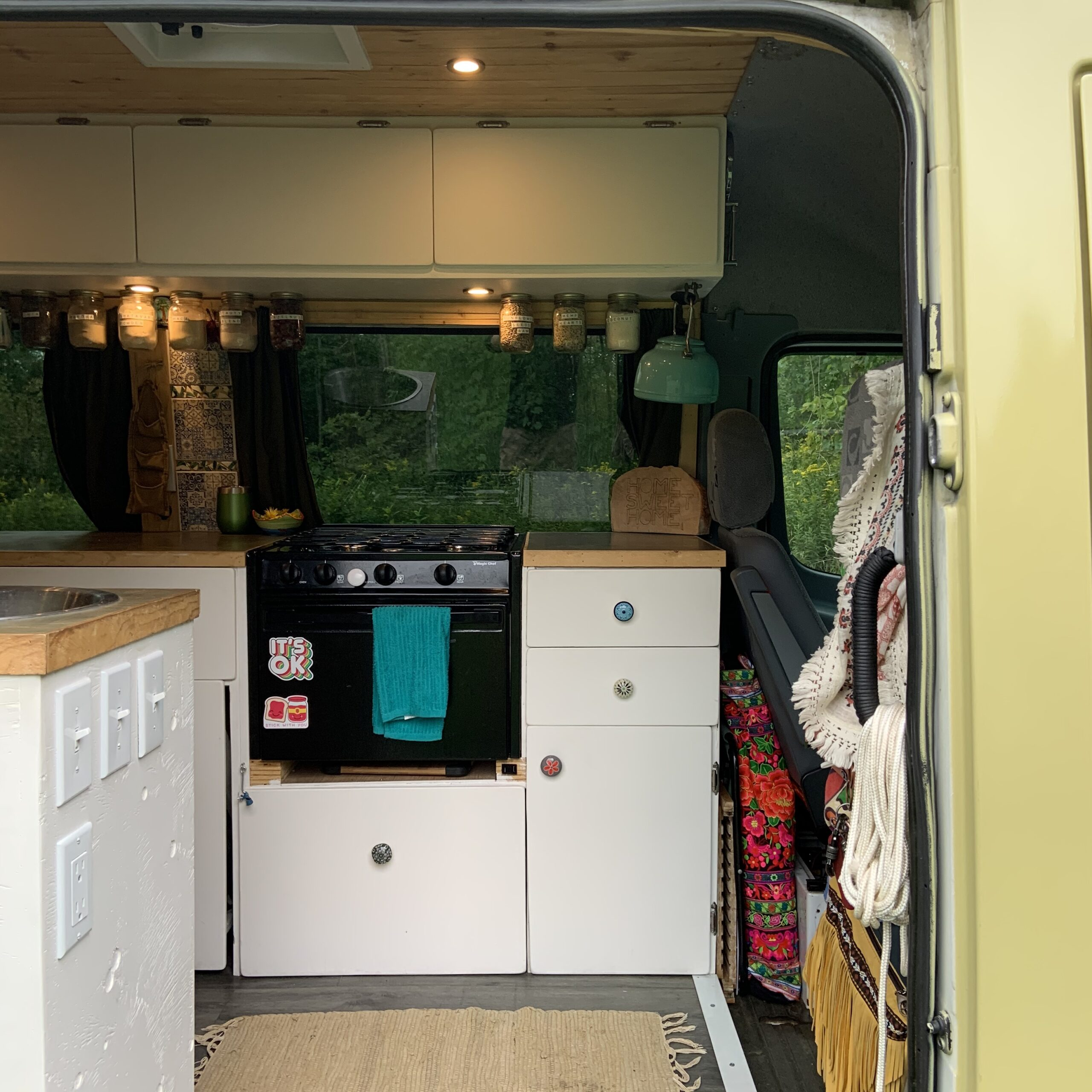 A clear shot of the DIY van conversion kitchen from the sliding door.