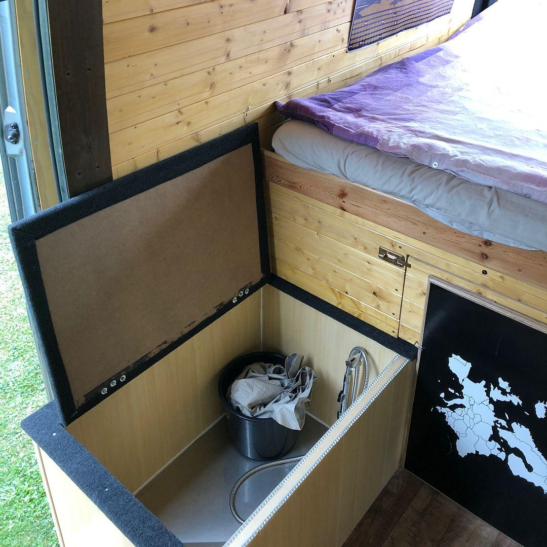 Vanlife shower inside of bench